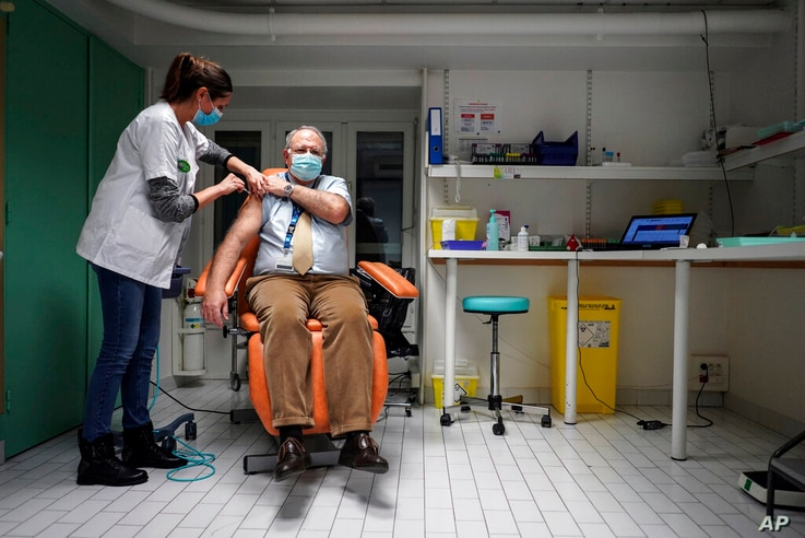 Dr. Christian Chidiac gets a Pfizer-BioNTech COVID-19 vaccine in La Croix-Rousse hospital, in Lyon, central France, Wednesday…