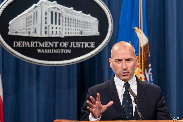Acting U.S. Attorney Michael Sherwin speaks during a news conference Tuesday, Jan. 12, 2021, in Washington. Federal prosecutors…
