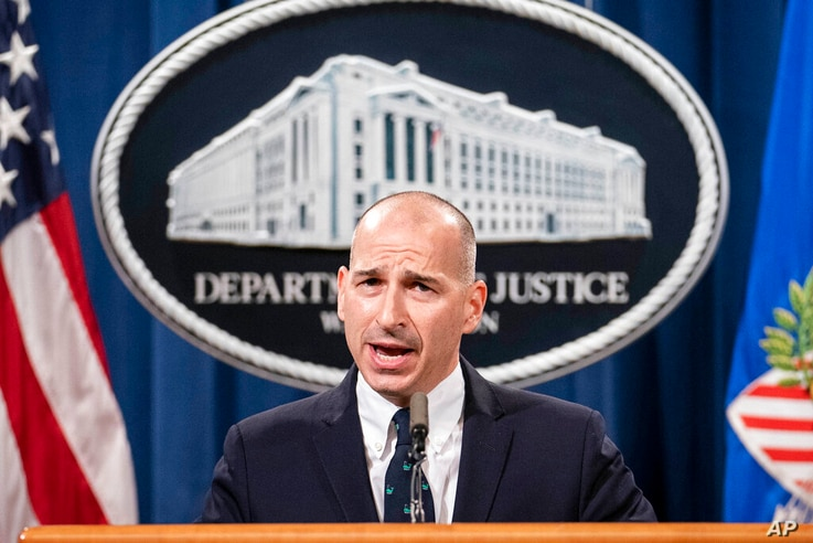 Acting U.S. Attorney Michael Sherwin speaks during a news conference Tuesday, Jan. 12, 2021, in Washington. Federal prosecutors...