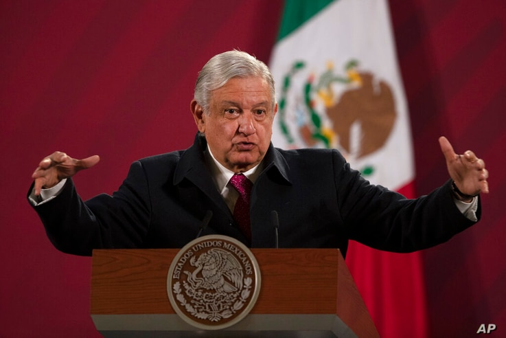 FILE - In this Dec. 18, 2020 file photo, Mexican President Andres Manuel Lopez Obrador gives his daily, morning news conference…