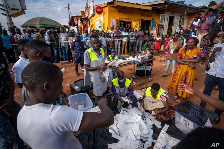 Election officials count the ballots after polls closed in Kampala, Uganda, Jan. 14, 2021.
