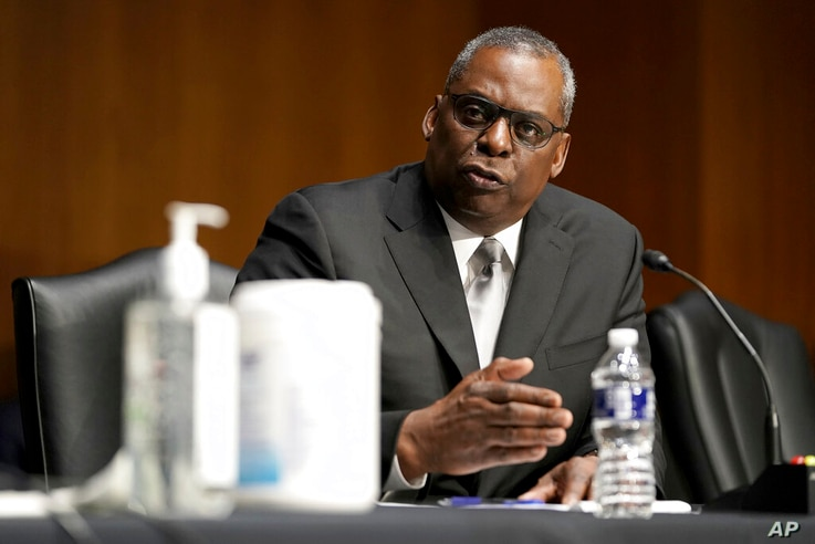 Secretary of Defense nominee Lloyd Austin, a recently retired Army general, speaks during his conformation hearing before the...
