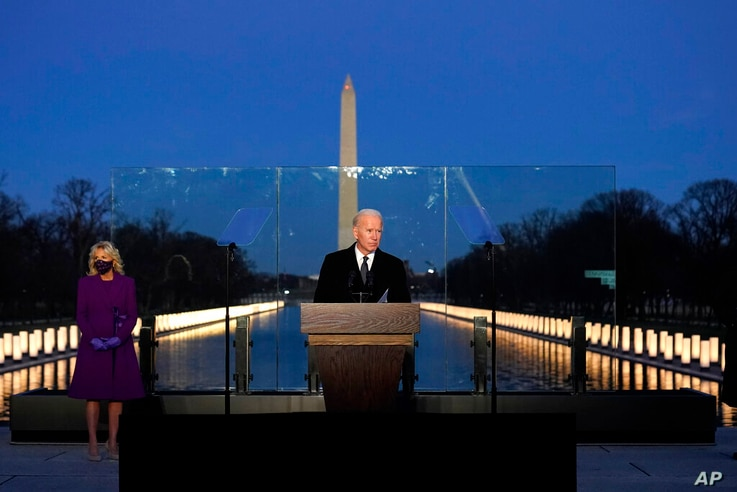 President-elect Joe Biden speaks during a COVID-19 memorial, with lights placed around the Lincoln Memorial Reflecting Pool,...