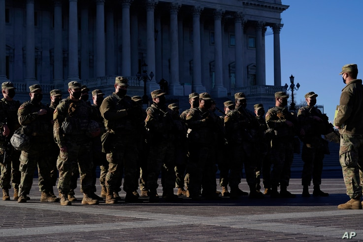 National Guard troops reinforce the security zone on Capitol Hill in Washington, Tuesday, Jan. 19, 2021, before President-elect…