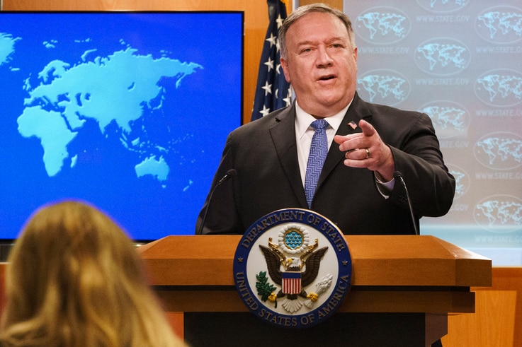 FILE - In this Nov. 10, 2020, file photo, Secretary of State Mike Pompeo gestures toward a reporter while speaking at the State...