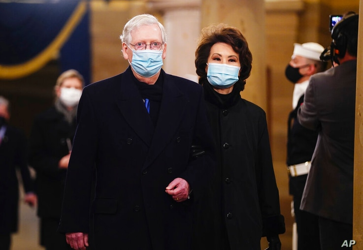 Sen. Mitch McConnell (R-Ky.) and former Secretary of Transportation Elaine Chao arrive in the Crypt of the US Capitol for…