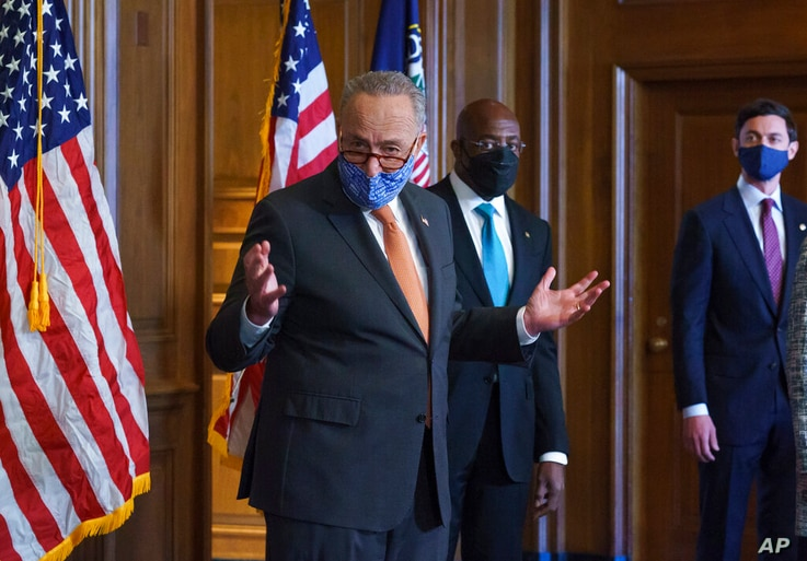 On the first full day of the Democratic majority in the Senate, Majority Leader Chuck Schumer, D-N.Y., left, is joined by Sen…