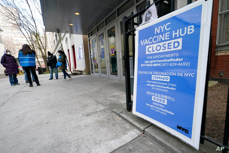FILE - In this Jan. 21, 2021, file photo, people who had appointments to get COVID-19 vaccinations talk to New York City health…