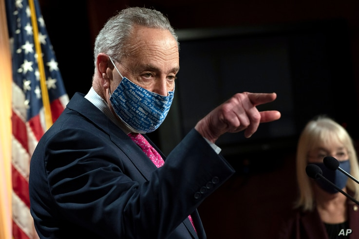 Senate Majority Leader Chuck Schumer of N.Y., left, speaks during a news conference with Sen. Patty Murray, D-Wash., right,…