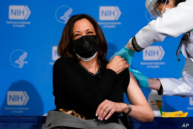 Vice President Kamala Harris reacts after receiving her second dose of the COVID-19 vaccine at the National Institutes of…