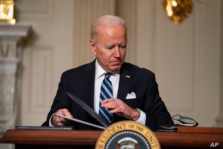 FILE - In this Jan. 27, 2021, file photo President Joe Biden signs a series of executive orders on climate change, in the State…