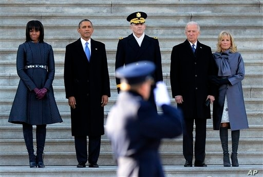 President Barack Obama, second from left, accompanied by, from left, first lady Michelle Obama, Army Maj. Gen. Michael J…