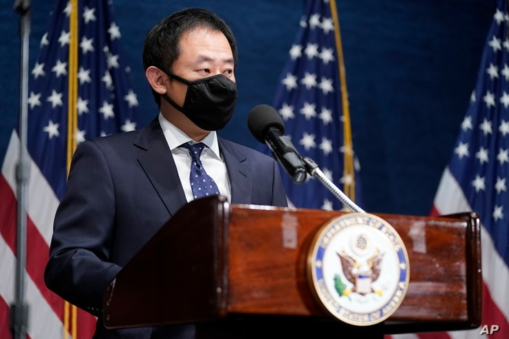 Xiyue Wang, a Chinese-American who was detained by Iran from 2016 to 2019, speaks at the National Press Club in Washington, Tuesday, January 12, 2021. (AP Photo/Andrew Harnik, Pool)