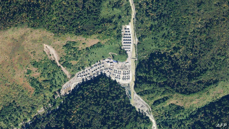This handout satellite photo taken Nov. 1, 2020, and obtained from Planet Labs, Inc. Jan. 20, 2021, shows a newly-constructed Chinese village in an area along the disputed India-China border.