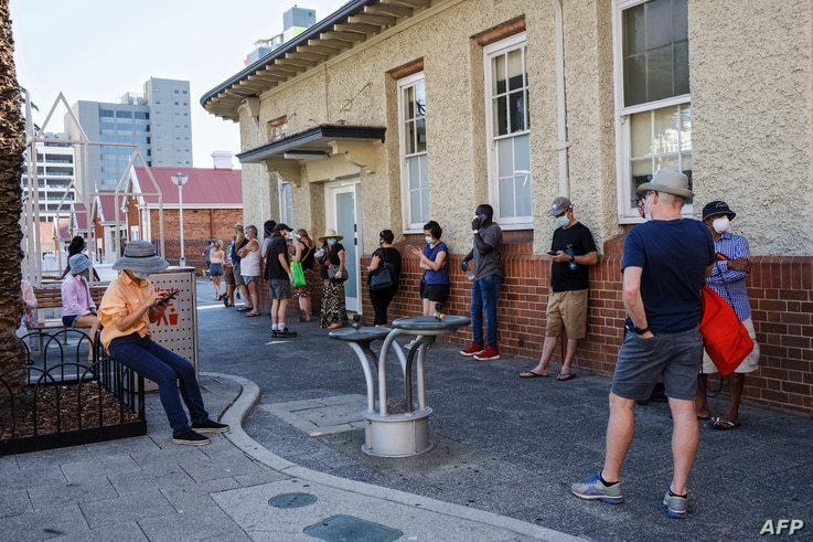 People wait in line to be tested for the coronavirus at Royal Perth Hospital, in Perth, Australia, Jan. 31, 2021.