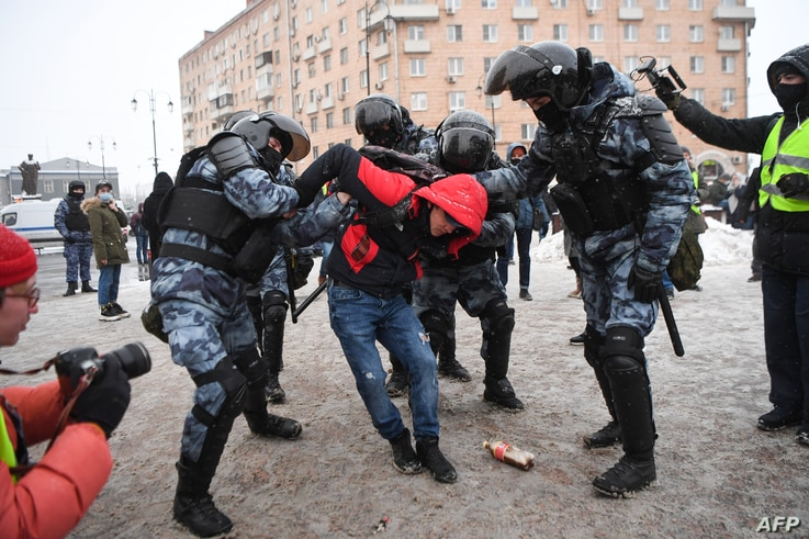 Riot police detain a man during a rally in support of jailed opposition leader Alexei Navalny in Moscow, Russia, Jan. 31, 2021.
