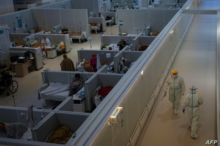 FILE - A general view of a makeshift hospital for coronavirus patients set up at the Sokolniki Exhibition and Convention Center in Moscow, Russia, Nov. 9, 2020.