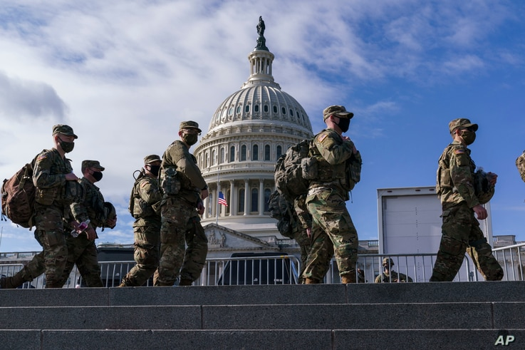 National Guard troops reinforce security around the U.S. Capitol ahead of the inauguration of President-elect Joe Biden and Vice President-elect Kamala Harris, Jan. 17, 2021.