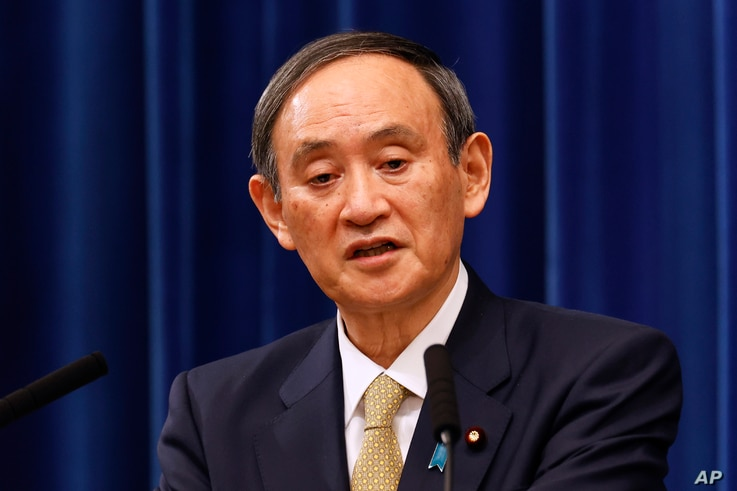 Japan's Prime Minister Yoshihide Suga speaks during a press conference at the prime minister's official residence in Tokyo, Jan. 13, 2021.