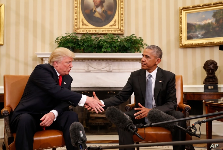 FILE - President Barack Obama shakes hands with President-elect Donald Trump in the Oval Office of the White House in Washington, Nov. 10, 2016.