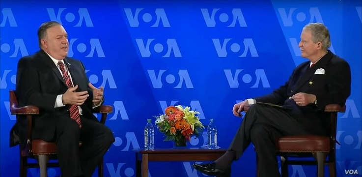 Secretary of State Michael Pompeo has a conversation with VOA Director Robert Reilly at the Voice of America headquarters in Washington, Jan. 11, 2021.