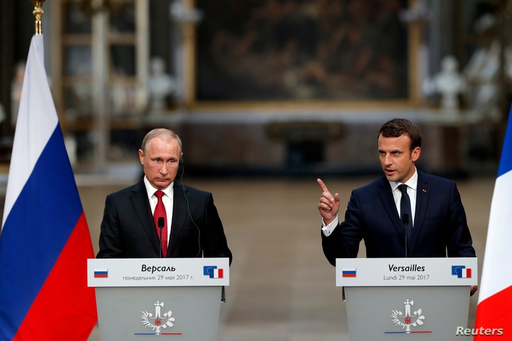 FILE - French President Emmanuel Macron (R) and Russian President Vladimir Putin are seen at a joint press conference in Versailles, France, May 29, 2017.