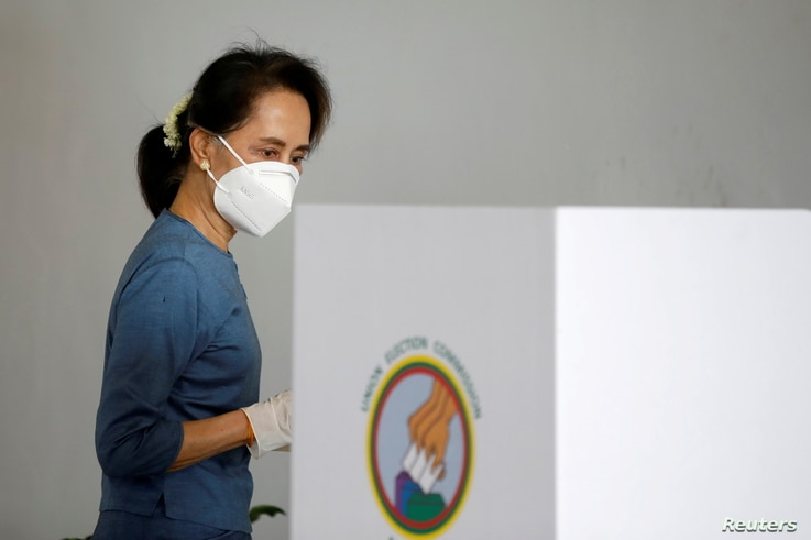 FILE - Myanmar State Counselor and de facto leader Aung San Suu Kyi arrives to vote early ahead of the Nov. 8 general election, in Naypyitaw, Myanmar, Oct. 29, 2020. According to a party spokesman, she and other have been detained in a early-morning raid.