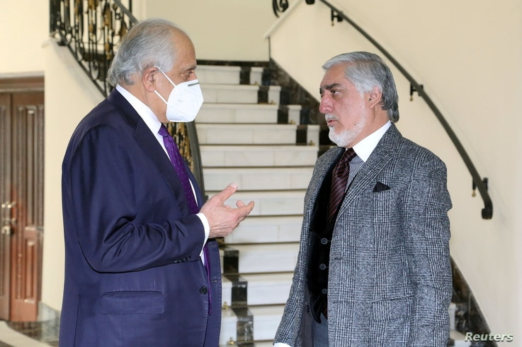 U.S. envoy for peace in Afghanistan Zalmay Khalilzad (L) talks with Abdullah Abdullah, Chairman of the High Council for National Reconciliation in Kabul, Afghanistan, Jan. 5, 2021.