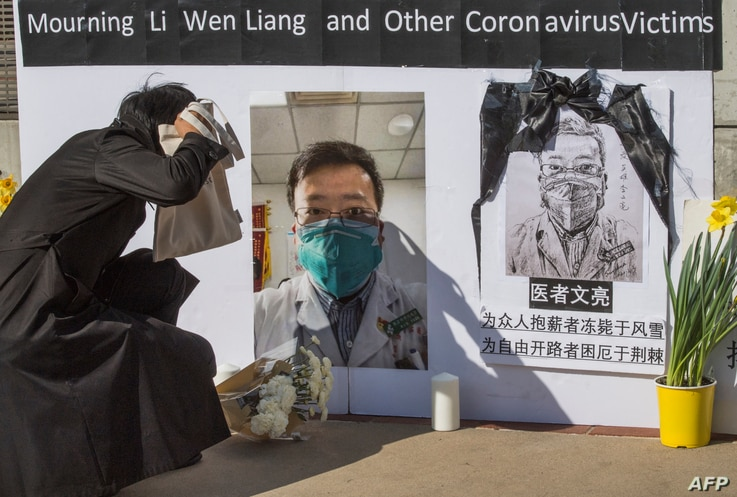 Chinese students and their supporters hold a memorial for Dr Li Wenliang, who was the whistleblower of the Coronavirus, Covid...