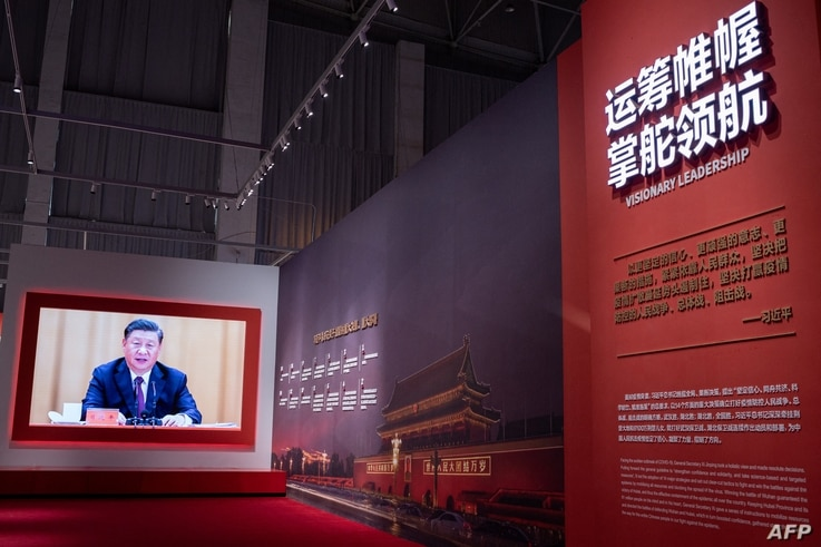 A video of China's President Xi Jinping plays at an exhibition about China's fight against the Covid-19 coronavirus at a...