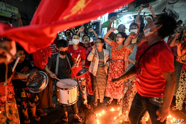 People take part in a noise campaign on the street after calls for protest against the military coup emerged on social media,…