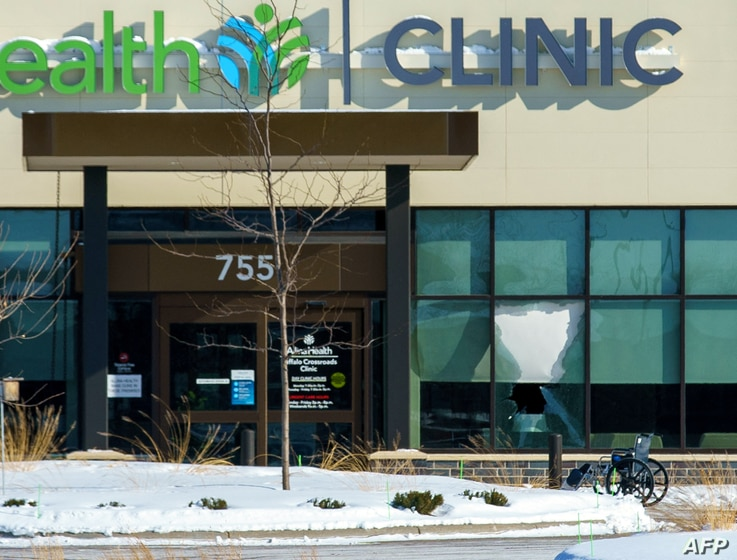 A broken window at the Allina Health Clinic in Buffalo, Minnesota on February 9, 2021, after a gunman opened fire inside. - The…