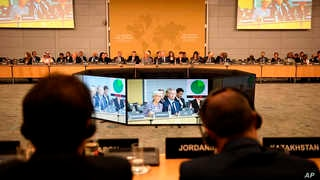 """Participants attend the """"No money for terror"""" conference at the Organization for Economic Cooperation and Development (OECD) in…"""