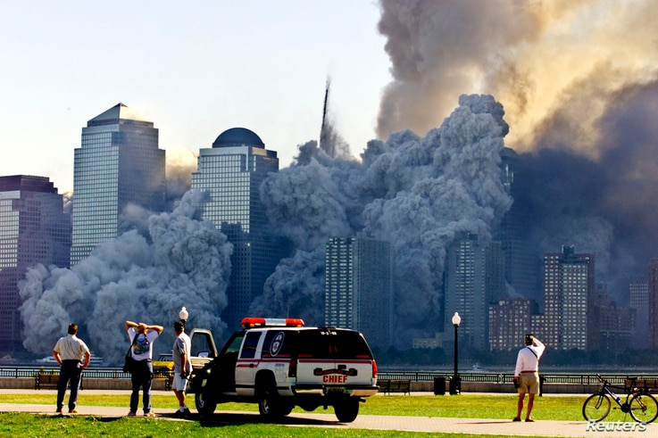The remaining tower of New York's World Trade Center, Tower 2, collapses in a cloud of dust and debris on September 11, 2001. Some conspiracy theorists believe the towers were demolished by powerful, unknown people or forces.