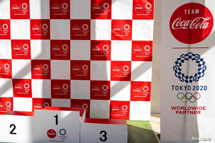 A banner advertising Coca-Cola, Olympic Games partner for Tokyo 2020, is pictured at the J-village compound ahead of the…