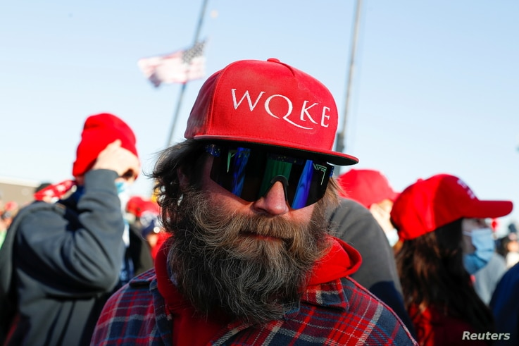A man wearing a cap that references the QAnon slogan attends a Trump campaign rally in Butler, Pennsylvania,October 31, 2020.
