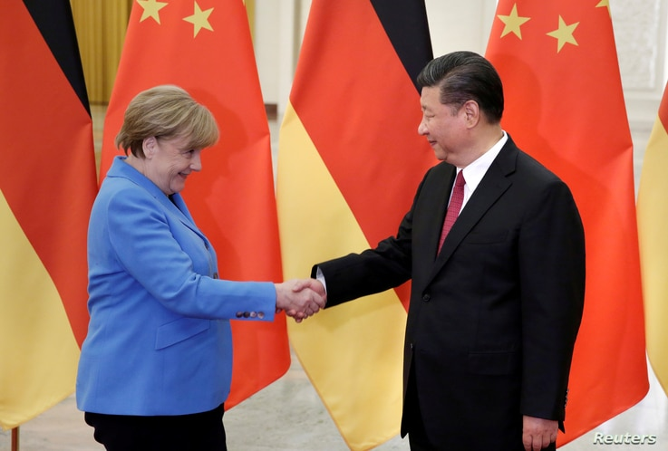 FILE PHOTO: China's President Xi Jinping (R) meets German Chancellor Angela Merkel at the Great Hall of the People in Beijing,…
