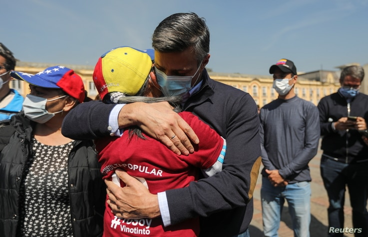 FILE - Venezuelan opposition politician Leopoldo Lopez embraces a person after participating in a popular consultation launched by opposition leader Juan Guaido to decline Venezuela's December 6 parliamentary election, in Bogota, Colombia Dec. 12, 2020.