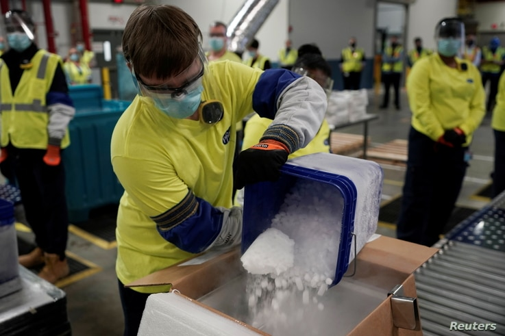 Boxes containing the Pfizer-BioNTech COVID-19 vaccine are prepared to be shipped at Pfizer Global Supply Kalamazoo