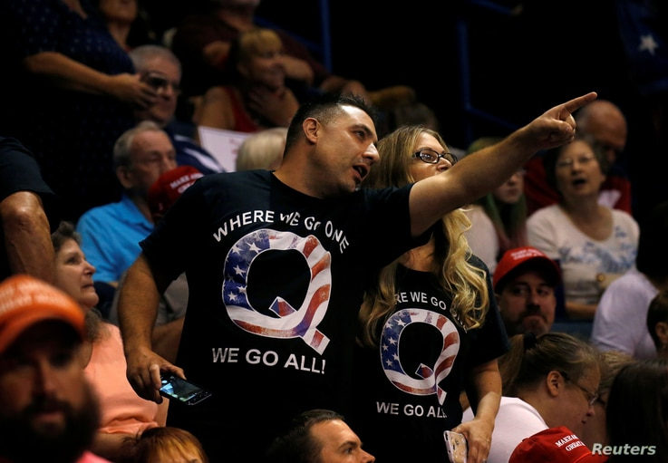 FILE -- Supporters wearing shirts with the QAnon logo at a Trump rally in Wilkes-Barre, PA, August 2, 2018.