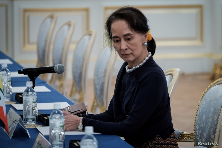 FILE - Myanmar's State Counsellor Aung San Suu Kyi waits for the arrival of her delegation before the Japan Myanmar Summit.