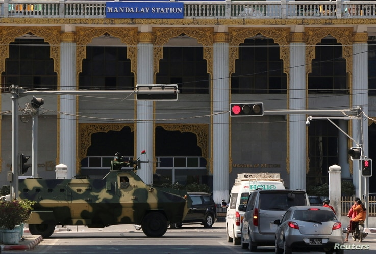 Myanmar army armoured vehicles drive past a street after they seized power in a coup in Mandalay, Myanmar February 2, 2021…