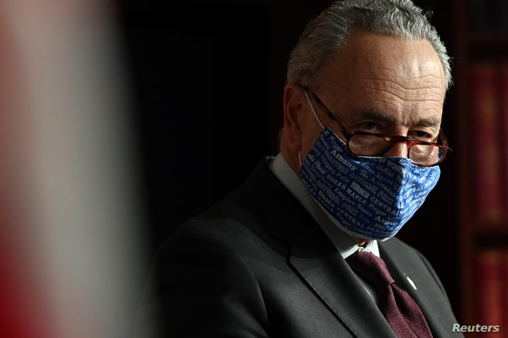 U.S. Senate Majority Leader Chuck Schumer (D-NY) looks on during a news conference at the U.S. Capitol, in Washington, U.S.,…