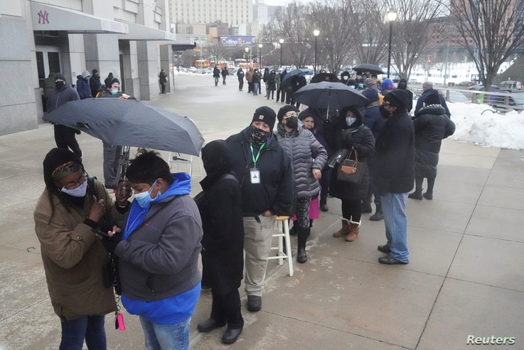 People line up outside Yankee stadium for vaccines amid the coronavirus disease (COVID-19) pandemic in the Bronx borough of New York City, New York, Feb. 5, 2021.