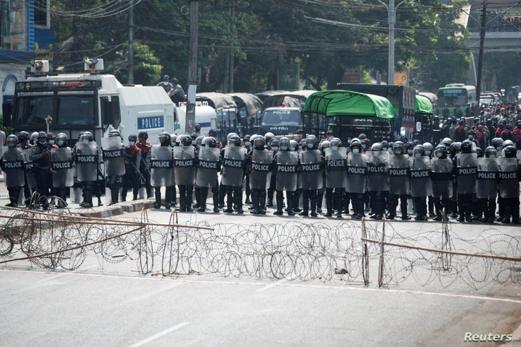 Riot police line up during a protest against the military coup demanding the release of elected leader Aung San Suu Kyi, in Yangon, Myanmar, Feb. 6, 2021.