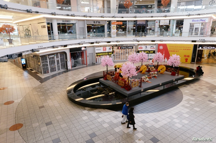 Shoppers walk past a Lunar New Year display at the Aberdeen Centre, which is named after the Aberdeen Harbour in Hong Kong, in…