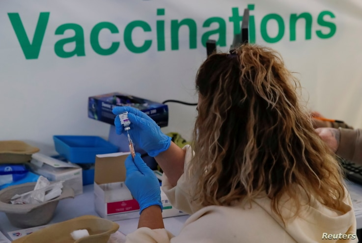 The AstraZeneca vaccine is prepared in the COVID-19 vaccination centre at the Odeon Luxe Cinema in Maidstone, Britain February...