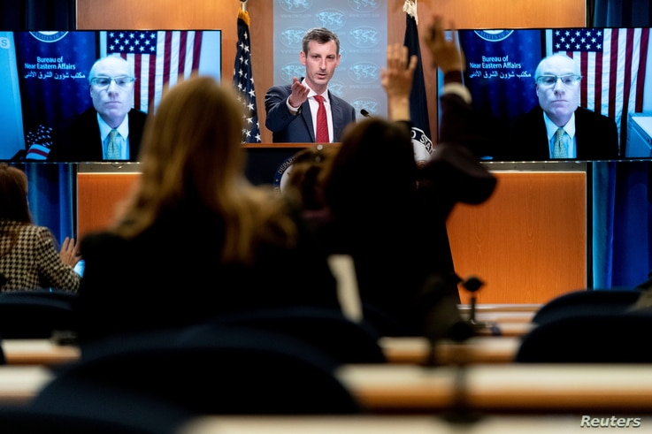 U.S. State Department spokesman Ned Price takes a reporter's question for Special Envoy for Yemen Timothy Lenderking at a State…