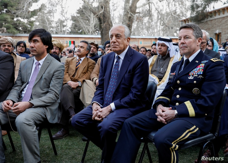 FILE PHOTO: U.S. envoy for peace in Afghanistan Zalmay Khalilzad (C) and U.S. Army General Scott Miller, commander of NATO's...