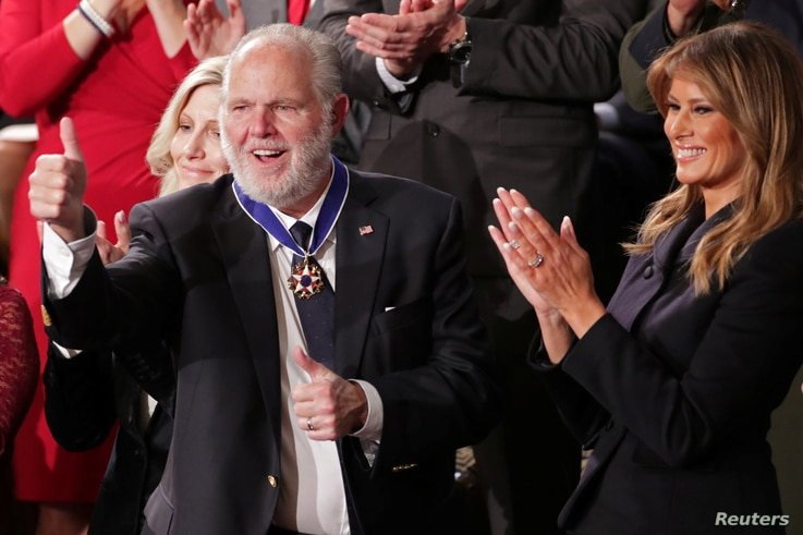 FILE PHOTO: Conservative radio talk show host Rush Limbaugh reacts as he is awarded the Presidential Medal of Freedom by U.S…